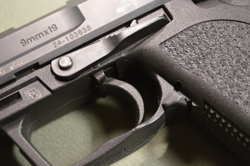 Notice the large slide release lever and unique magazine release.