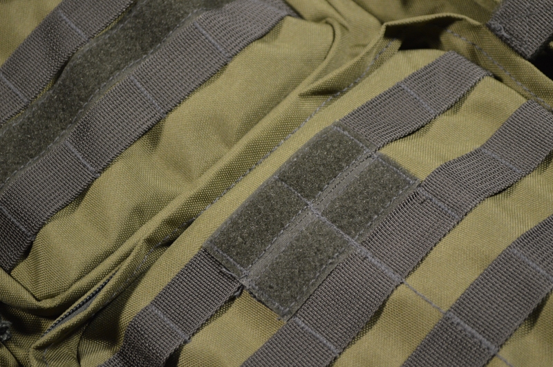 MOLLE webbing and Velcro for patches.